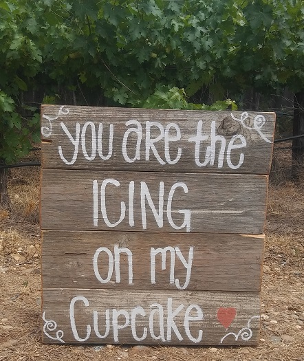 Wooden sign Icing On My Cupcake rentals from Brave Horse Winery